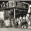 "Photo provided by Lorain Historical Society <br> State Theater at 375 Broadway Ave., shows a lineup of horses and people wtih a marquee listing ""Vodvil and Photo Play."" The State Theater was destroyed in a deadly 1924 Tornado."