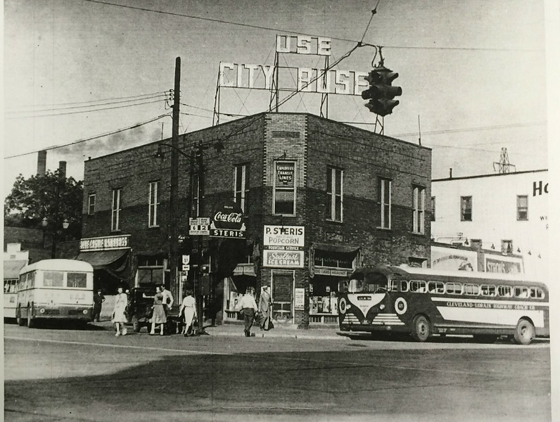 "Photo provided by Lorain Historical Society <br> ""Use city buses"" is a message on a P. Steris building and Employee Transit Lines on the northwest corner of the loop area in downtown Lorain."