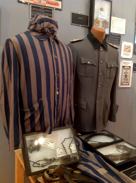 Jennifer Huberdeau/North Adams Transcript  A uniform worn in the concentration camps and another worn by a member of the Nazi Party, are on display at the New England Holocaust Institutue and Museum on Eagle Street in North Adams.