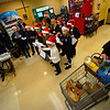 """Area children bring holiday cheer to Hannaford, in Brattleboro, Vt., during a """"Project Free the Thousand"""" event on Friday, 15, 2017."""