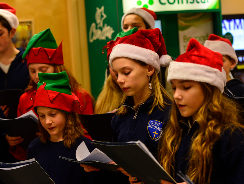 """KRISTOPHER RADDER - BRATTLEBORO REFORMER<br /> Children from St. Michael's Catholic School sing Christmas carols at Hanford, in Brattleboro, Vt., during a """"Project Free the Thousand"""" event on Friday, 15, 2017."""