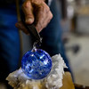 KRISTOPHER RADDER — BRATTLEBORO REFORMER<br /> Using a small amount of the heated glass, DuGrenier makes the ring on top of the ornament for it to be hung.
