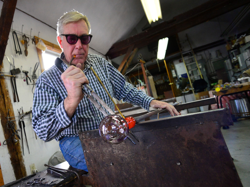KRISTOPHER RADDER — BRATTLEBORO REFORMER<br /> Robert DuGrenier, of Townshend, Vt., works on making glass ornaments for the big push before Christmas weekend. Dugrenier can make nearly 100 ornaments a day, around one every three minutes.  DuGrenier has been blowing glass since 1973. He offers classes Wednesdays and Saturdays after 3:30 p.m. Call for an appointment at 802-365-4400.