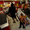 KRISTOPHER RADDER - BRATTLEBORO REFORMER<br /> Jane Sousie, of Hinsdale, N.H., waits in line to buy a TV with her son and his friend at the Target in Keene,  N.H., on Thursday, Nov. 23, 2017.