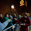 KRISTOPHER RADDER - BRATTLEBORO REFORMER<br /> Keith Hopkins, assets protection at Target in Keene, N.H., hands out tickets for the big sale items to people in line.