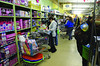 Families who received vouchers for the Northern Berkshire Santa Fund do their gift shopping at Cariddi Sales on State Road in North Adams on Friday, Dec. 20, 2013. (Gillian Jones/North Adams Transcript)