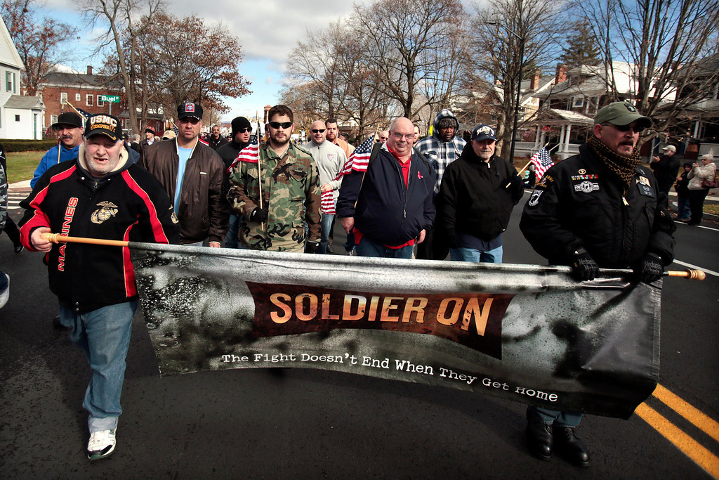 . Veterans from Soldier On march in the Veterans Day parade down South Street to the war memorial in downtown Pittsfield on Monday, November 11, 2013. (Stephanie Zollshan | Berkshire Eagle Staff)