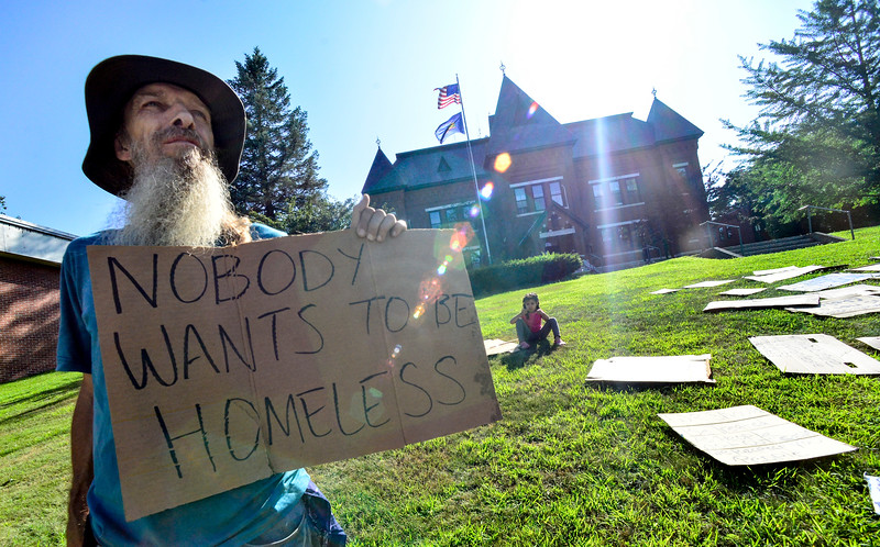 KRISTOPHER RADDER — BRATTLEBORO REFORMER<br /> James Douglas and others hold signs as part of the Homeless Revolution outside the Municipal Building, in Brattleboro, on Friday, Aug. 9, 2019.