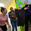 KRISTOPHER RADDER — BRATTLEBORO REFORMER<br /> Samantha Soskin smiles as Lt. Adam Petlock hands her a shirt with her name on it during a small ceremony on Wednesday, Dec. 18, 2019. The five people were recognized for their work with a certificate and clothing to identify them with Project CARE.