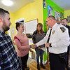 KRISTOPHER RADDER — BRATTLEBORO REFORMER<br /> Samantha Soskin shakes the hand of Brattleboro Police Chief Michael Fitzgerald while she and four others were recognized for their work with Project CARE on Wednesday, Dec. 18, 2019.