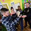 KRISTOPHER RADDER — BRATTLEBORO REFORMER<br /> Brattleboro Police Chief Michael Fitzgerald thanks the recovery coaches at Turning Point for their work in Project CARE during a small ceremony on Wednesday, Dec. 18, 2019. The five people were recognized for their work with a certificate and clothing to identify them with Project CARE.