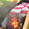 KRISTOPHER RADDER — BRATTLEBORO REFORMER<br /> Members of the Brattleboro Elks Lodge burn old American Flags on Flag Day on Friday, June 14, 2019. Members will also be burning flags on Saturday morning if anyone has any old flags that they want to discard.