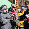 KRISTOPHER RADDER — BRATTLEBORO REFORMER<br /> Arthur Philbrick, former commander of the American Legion Post 86, in Chesterfield, N.H., hands out flowers to those in attendance during an  Veterans Day ceremony hosted by the American Legion Post 86 on the United States Navy Seabee Bridge on Sunday, Nov. 11, 2018.