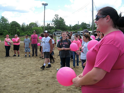 BOB SANDRICK / GAZETTE Family members and friends of Kelli Baker; Michael Funk, who died in a motorcycle crash last year; and the Ulferts family of Homerville, who recently lost a horse, prepare to release balloons Saturday during the Kelli's C.R.U.S.A.D.E. horse show at the Medina County Fairgrounds.
