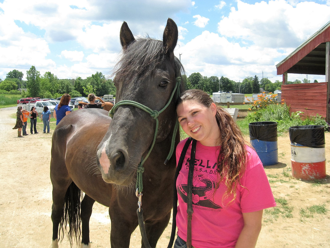 BOB SANDRICK / GAZETTE  Kelsey Spencer trained her horse Baker, a mustang from Wyoming, in 100 days. She named the horse after her best friend, Kelli Baker.