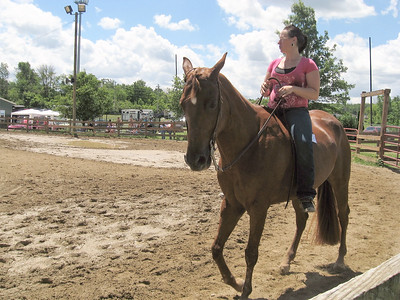 BOB SANDRICK / GAZETTE  A rider walked a horse at the fifth annual Kelli's C.R.U.S.A.D.E horse show Saturday at Medina County Fairgrounds.