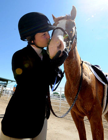 "Madison McKenzie gives her horse a kiss after winning a blue ribbon  during English showmanship on Thursday at the Boulder County Fair in Longmont.<br /> For more photos and video of horses, go to  <a href=""http://www.dailycamera.com"">http://www.dailycamera.com</a>.<br /> Cliff Grassmick / July 28, 2011"