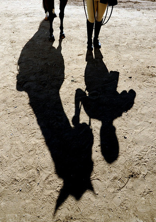 "The shadow of Jordan Kranlick and her horse, Hank,  outside the arena during English showmanship on Thursday at the Boulder County Fair in Longmont.<br /> For more photos and video of horses, go to  <a href=""http://www.dailycamera.com"">http://www.dailycamera.com</a>.<br /> Cliff Grassmick / July 28, 2011"