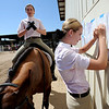 "Madison Gabler, left,  and Maddie Uilk, prepare for the rest of their day at the  English showmanship on Thursday at the Boulder County Fair in Longmont.<br /> For more photos and video of horses, go to  <a href=""http://www.dailycamera.com"">http://www.dailycamera.com</a>.<br /> Cliff Grassmick / July 28, 2011"