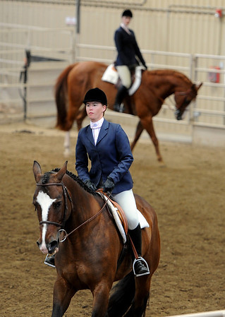 "Katie Richardson goes through her routine  during English showmanship on Thursday at the Boulder County Fair in Longmont.<br /> For more photos and video of horses, go to  <a href=""http://www.dailycamera.com"">http://www.dailycamera.com</a>.<br /> Cliff Grassmick / July 28, 2011"