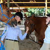 "Dillon the horse appears to be sticking his tongue out at Caroline Farmer, as Lauren DeGroot laughs. They were talking before English showmanship on Thursday at the Boulder County Fair in Longmont.<br /> For more photos and video of horses, go to  <a href=""http://www.dailycamera.com"">http://www.dailycamera.com</a>.<br /> Cliff Grassmick / July 28, 2011"