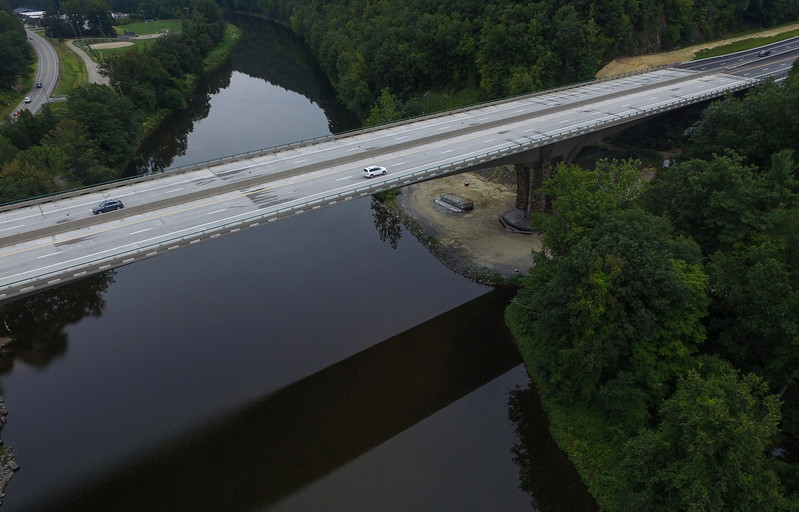 KRISTOPHER RADDER - BRATTLEBORO REFORMER<br /> Work wraps up on the new I-91 Bridge over the West River on Tuesday, Aug. 29, as the old bridge disappears into memory and photos.