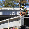 Crews attach the beam to the crane before they lift it for the  I-91 Bridge over Upper Dummerston Road on Thursday, March 3, 2016. Kristopher Radder / Reformer Staff