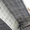 Crews examine and smooth out sections of the I-91 Bridge. Kristopher Radder / Reformer Staff