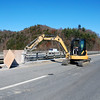 Kayla Rice/Reformer<br /> Workers remove the granite from the edges of the highway during the renovation of the I-91 Bridge in Brattleboro.