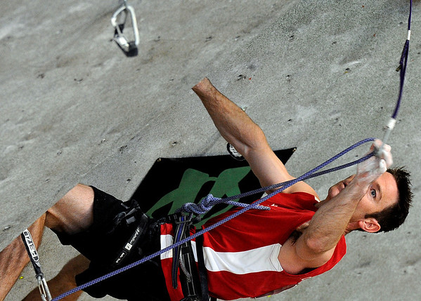 "Team Canada's Mike Doyle clips his rope into a carabiner while competing in a International Federation of Sport Climbing (IFSC) Lead World Cup competition on Saturday, Oct. 8, at Movement Climbing and Fitness on 28th Street in Boulder. For more photos and a video of the event go to  <a href=""http://www.dailycamera.com"">http://www.dailycamera.com</a><br /> Jeremy Papasso/ Camera"