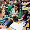 20130116_STREAM_115.jpg Stephanie Schroeder, center, program manager of STREAM, helps fifth-graders Jamie Luna, left, and Vienna Manzanares with an exercise involving iPads and Google Earth at Ryan Elementary School in Lafayette on Wednesday, Jan. 16, 2013. <br /> (Greg Lindstrom/Times-Call)