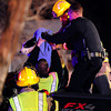 A dog is rescued from the bed of a pickup truck involved in a multi car accident at the intersection Iris Avenue and 19th Street in Boulder<br /> <br /> Photo by Paul Aiken / The Camera /