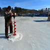 KRISTOPHER RADDER - BRATTLEBORO REFORMER<br /> John Lynde, of Brattleboro, uses a motorized auger to cut into the ice.