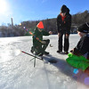 KRISTOPHER RADDER - BRATTLEBORO REFORMER<br /> Adam Newton, 15, pulls out a perch while Tanner Bell, 17, and Jett Emery, 10, looks on.