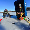 KRISTOPHER RADDER - BRATTLEBORO REFORMER<br /> Henry Thurber, 13, from Brattleboro, sits in his shelter he got for Christmas while fishing with his friend Ernie Antonucci, 14, of Brattleboro. Thurber said the always liked regular fishing, but started ice fishing  two years ago and really enjoyed it.