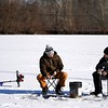 BEN GARVER — THE BERKSHIRE EAGLE<br /> Ice fishermen Andrew Koch and Corbin Richardson  use jigs on the Cheshire Reservoir, Thursday, December 27, 2018, Cheshire, Mass. The ice is 6 inches thick where the men are fishing, but open water exists near areas with current near the outlets; only experts should venture out on the ice.