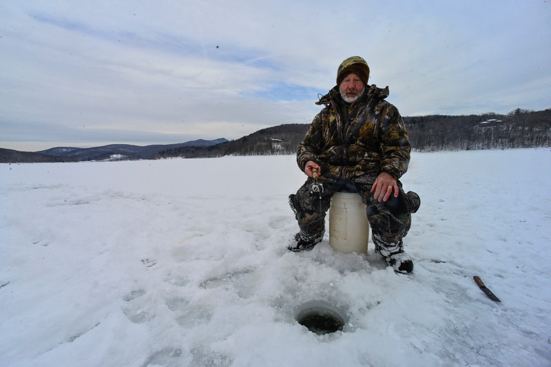 KRISTOPHER RADDER - BRATTLEBORO REFORMER <br /> Ed Brozo, of Bernstein, Mass., waits for a bite while ice fishing at Harriman Reservoir, in Wilmington, Vt., on Thursday, Feb. 1, 2018.