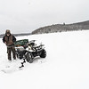 KRISTOPHER RADDER - BRATTLEBORO REFORMER <br /> Using a four-wheeler Roger Crawford, of Wilmington, travels across the Harriman Reservoir, in Wilmington, Vt., in search for the right spot to catch a fish while ice fishing on Thursday, Feb. 1, 2018.
