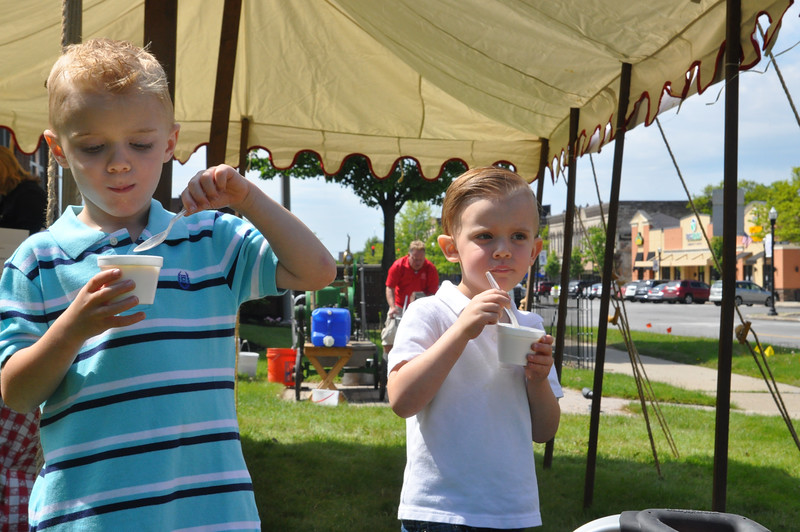 """ASHLEY FOX / GAZETTE Rory, 5, left and his 3-year-old brother """"D,"""" right, Kline, both of Wadsworth enjoy ice cream at the Wadsworth History Day after church."""