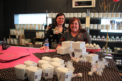 HALEE HEIRONIMUS / GAZETTE Mother-daughter duo Lauri, right, and Sarah Burke, left, own Half Caked Treats, based out of their home in Seville. The duo specializes in gourmet cake truffles and cupcakes. Half Caked Treats was on display at Funky Junk Boutique in downtown Seville.