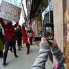 KRISTOPHER RADDER - BRATTLEBORO REFORMER<br /> Lydia Donahue, 7, of Brattleboro, takes photos of a group of people marching down Main Street in Brattleboro, Vt., on Wednesday, March 8, 2017. The march was organized by the Brattleboro based Women's Action Team, to show support for International Women's Day.