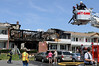 Latham firefighters battled a fire that destroyed four apartments in Building 22 at the Valley View Apartments off Johnson Road.  (Mike McMahon / The Record)
