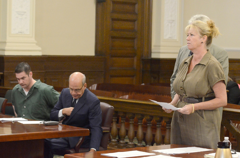 Vicki Hart (mother of Nikki Hart) reads victim impact statement (r) as attorney Stephen Coffey (m) and Jason Guynup (l) listen during the sentencing of Guynup for the murder of his ex-girl friend Nikki Hart Monday, August 26, 2013 at Rensselaer County Court  in Troy, N.Y.. (J.S.CARRAS/THE RECORD)