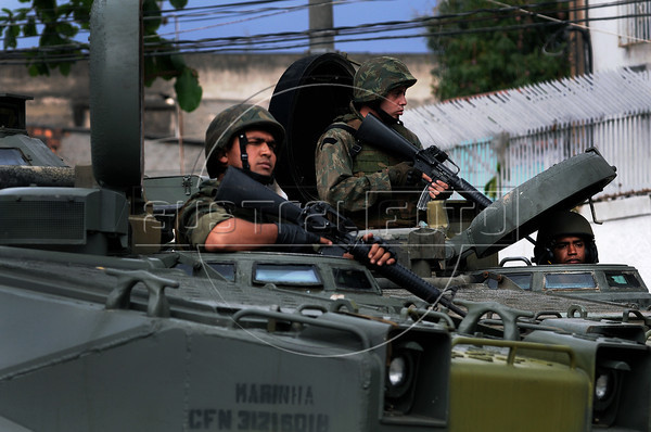 Brazilian marine armoured Amphibious Assault Vehicles giving support to police block a street during a deployment to pacify the Manguinhos and Jacarezinho shantytowns, known as 'Crackland', Rio de Janeiro, Brazil, October 14, 2012. (Austral Foto/Renzo Gostoli)