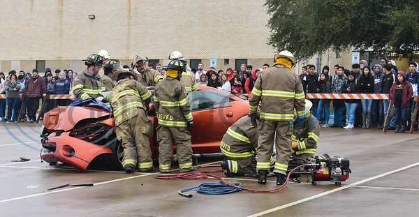 "Hundreds of East Texas students watch as first responders use the jaws of life to free a student ""actor"" from a vehicle during the reenactment of a drunk driving accident during a Shattered Dreams program on Tuesday, February 11. The event took place at John Alexander Gym in Jacksonville. (Jessica T. Payne/Tyler Morning Telegraph)"