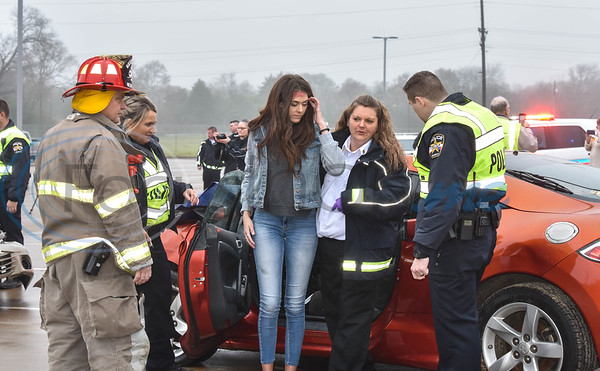 Police Officers take a student acting as a drunk driver out of a vehicle during the reenactment of a drunk driving accident on Tuesday, February 11. The presentation was part of the Shattered Dreams program put on by the Texas Department of Transportation to show the impact of drinking and driving to high school students. (Jessica T. Payne/Tyler Morning Telegraph)