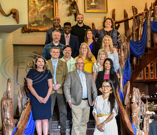 The 33rd graduating class of the Jacksonville Leadership Institute gather on stairs following the programs graduation ceremony at Castle on the Lake that also included a luncheon and awards presentation on Tuesday.
