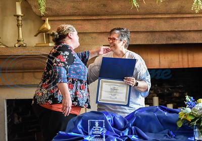 Amy Harmon of UT Health Jacksonville (left) and Jacksonville Leadership Institute Co-Chair Shannon Hitt embrace as Harmon receives her diploma from the program on Tuesday.