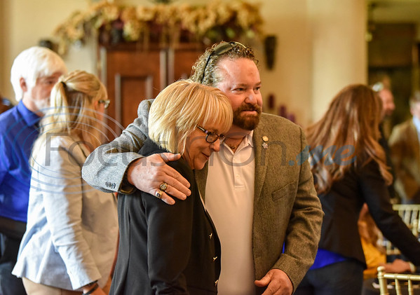 Jacksonville Chamber of Commerce President Peggy Renfro (left) and Republic Services Government Affairs Manager Gene Keenon greet each other at the Jacksonville Leadership Institute graduation held at Castle on the Lake in Jacksonville on Tuesday.