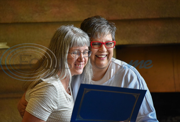 Jacksonville Leadership Institute graduate Monica Maberry (left) smiles as she receives her diploma from Leadership Co-Chair Shannon Hitt on Tuesday. The graduation ceremony took place at Castle on the Lake.